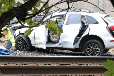 PHOTOS: Freight Train Pushes SUV From Dumont Into Bergenfield