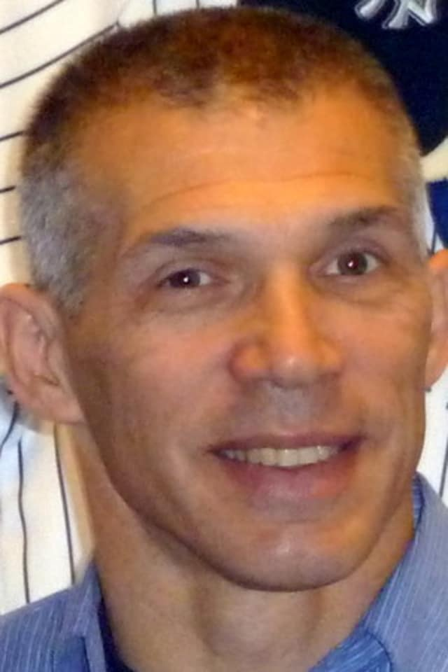 The Yankees may have to fight to keep Purchase resident Joe Girardi managing in the Bronx.