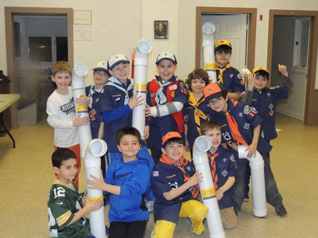 Cub Scouts made the bins with PVC pieces.
