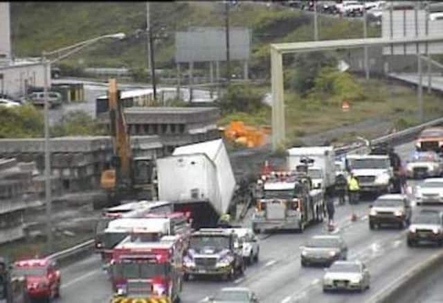 Work crews are working to remove a tractor-trailer that went down an embankment on I-95 in Stratford.
