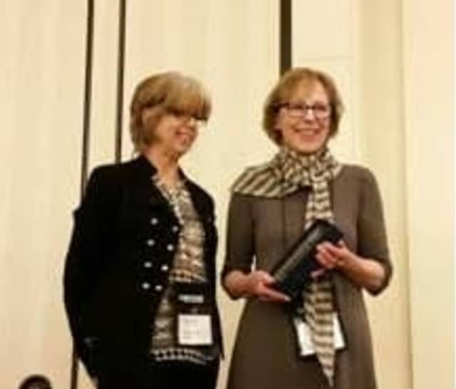 Alice Sherwood, right, receives the Connecticut Library Association Career Achievement Award from Mary Beth Rassulo, member of the association's Selection Committee.